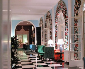 Dorothy Draper's floral curtains, bold floor and bright colors at the Greenbrier